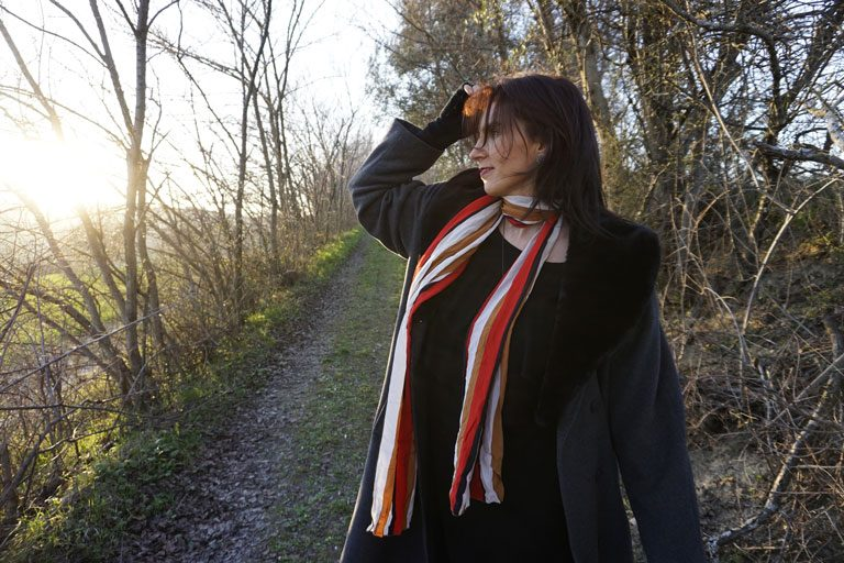 Composer Olivia Belli is on a sunset walk through the forest